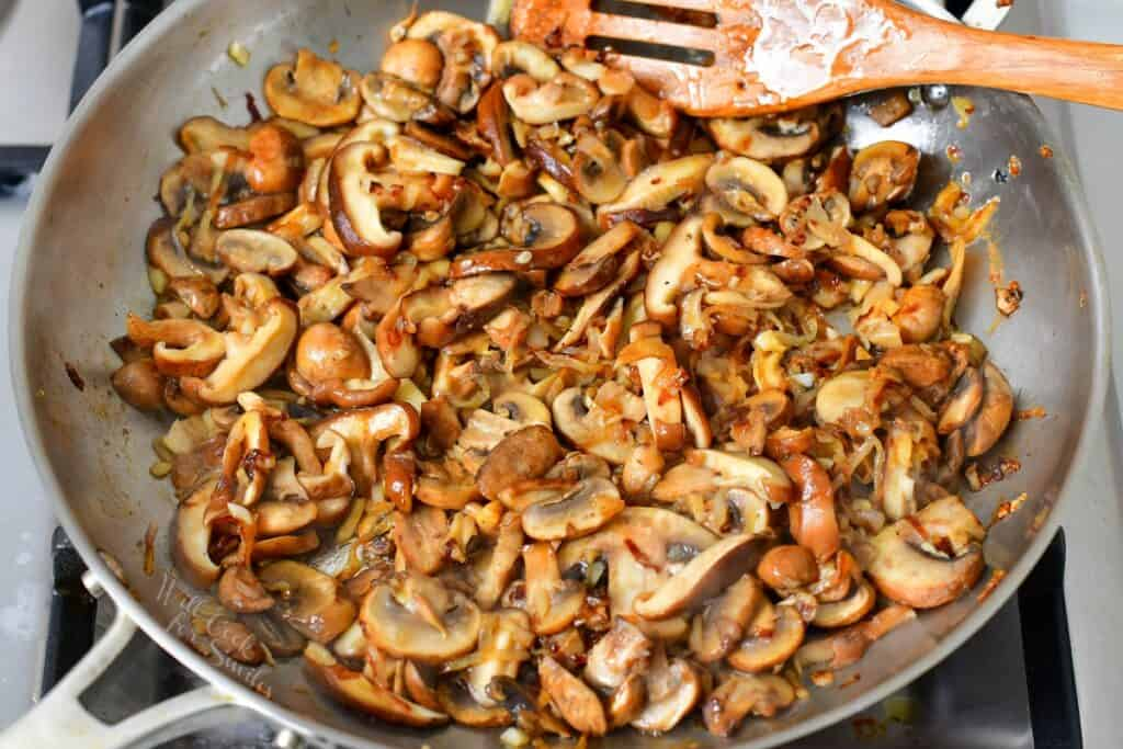 sautéed mushrooms and onion in the pan