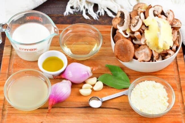 ingredients for the mushroom sauce on a cutting board