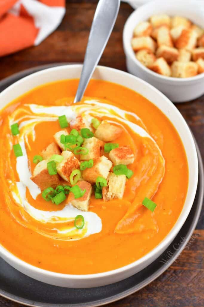 top view of sweet potato soup in a bowl with croutons