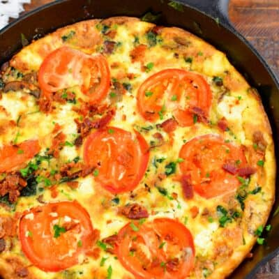 top view of a whole frittata in a cast iron skillet